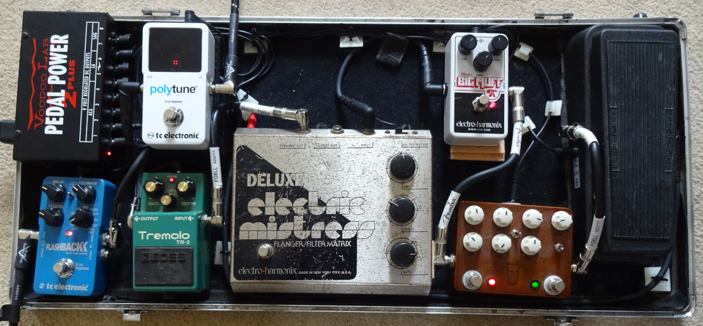 Guitar effects pedals on a pedalboard